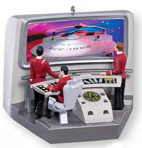 Admiral Kirk and Captain Spock watch from the bridge of the starship Enterprise as another ship approaches.