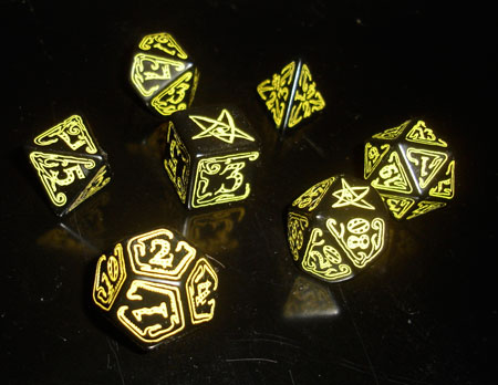 Black dice with yellow stylized numbering. The highest number on each die is an elder sign.