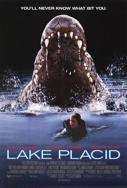 A giant crocodile chases a swimmer in a lake.