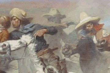 Cowboys on horseback.