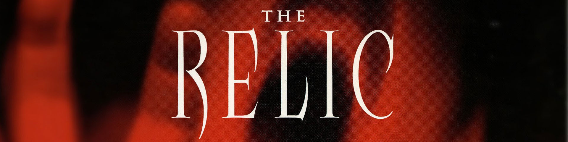 """The words """"The Relic"""" written over a distorted, screaming red face. The face appears over a black background."""