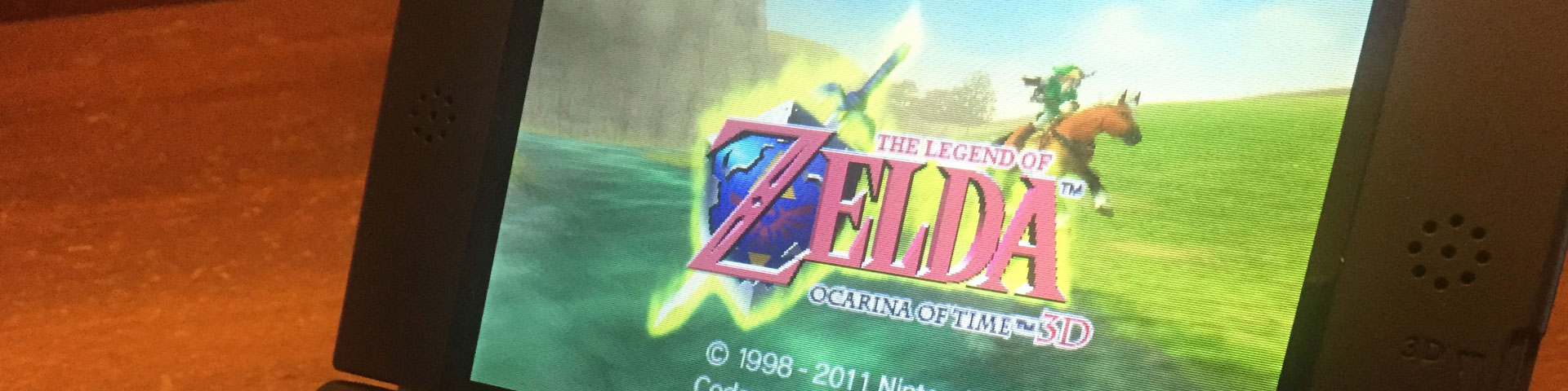 A close-up shot of the Legend of Zelda: Ocarina of Time load screen on a Nintendo 3DS handheld.