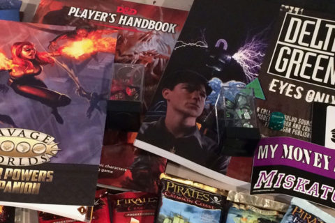A cross section of the RPG source books, card games, and bumper stickers I got at GenCon.
