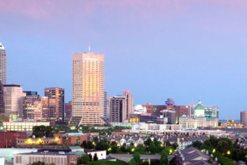 The Indianapolis skyline, with a blue-pink sky in the background.