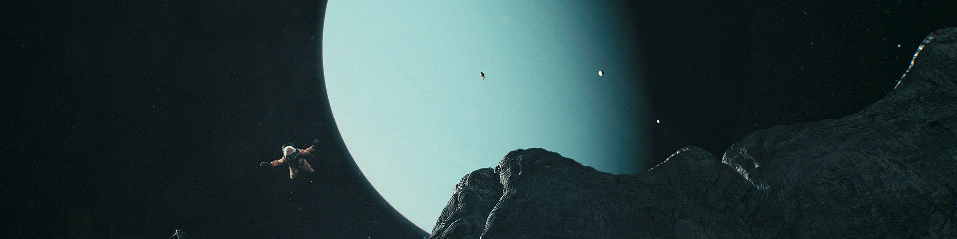 Explorers jump from cliffs on a moon of Uranus. The blue gas giant rises in the background.
