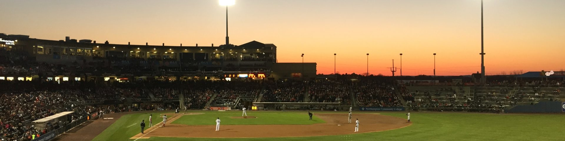 Sunset at an early spring IronPigs baseball game. The big AAA lights are lit up and the sky is just beginning to fade to black.