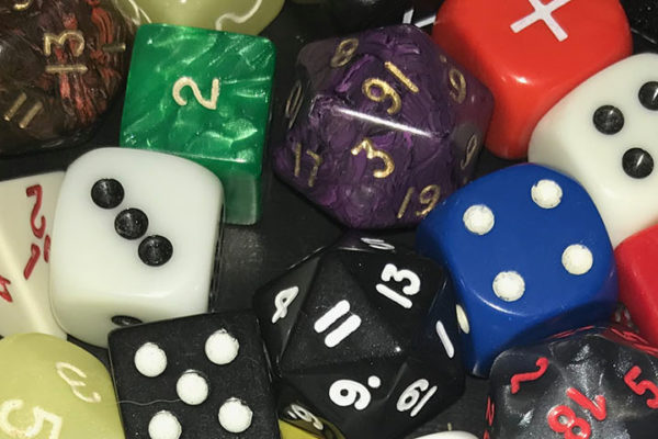 A collection of dice of different size and colors.
