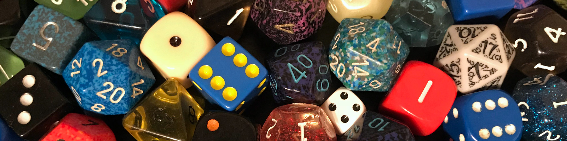A number of different polyhedral dice.