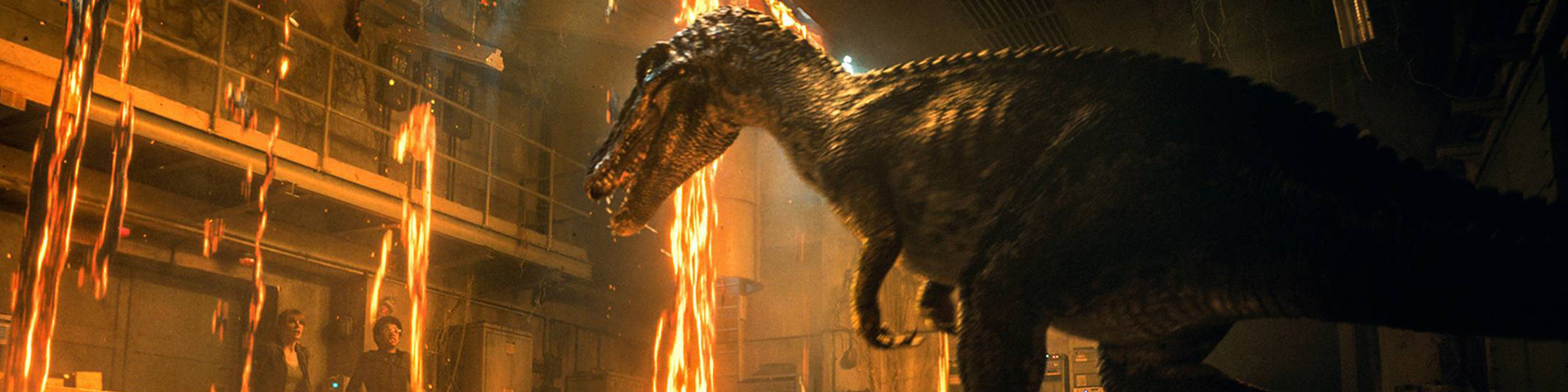 A bipedal dinosaur appears in a burning building, threatening a man and a woman who appear off to the left.