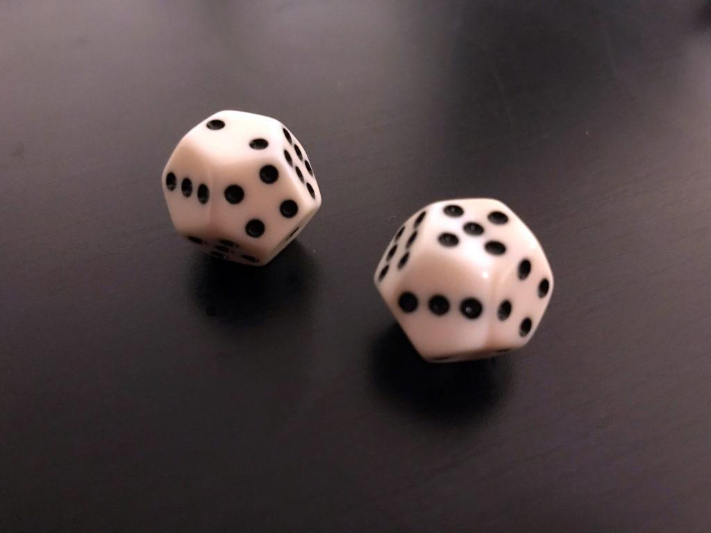 Twelve-sided dice numbered 1-6 twice.